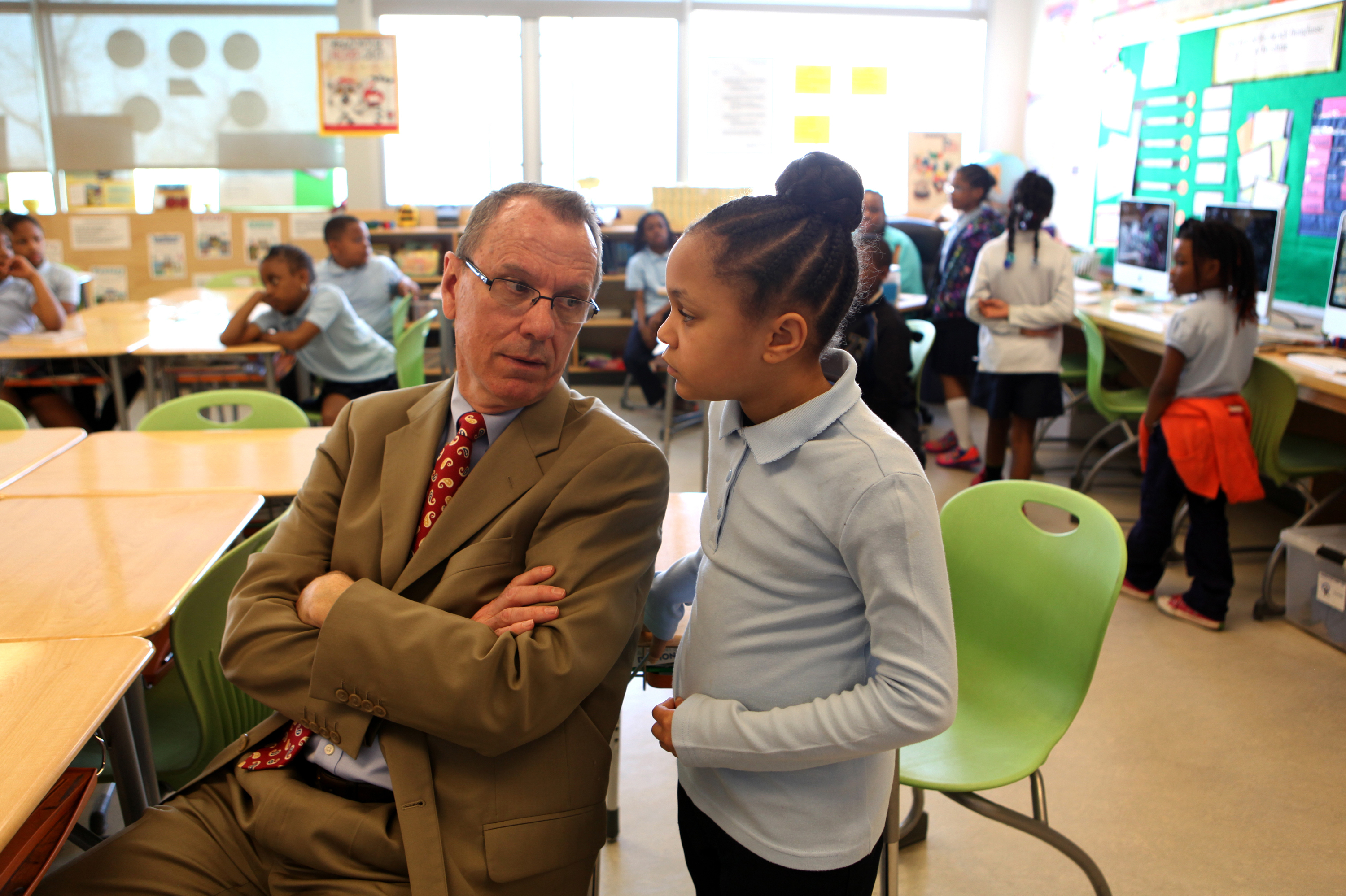 Savoy's principal, Patrick Pope, sits in on a class.