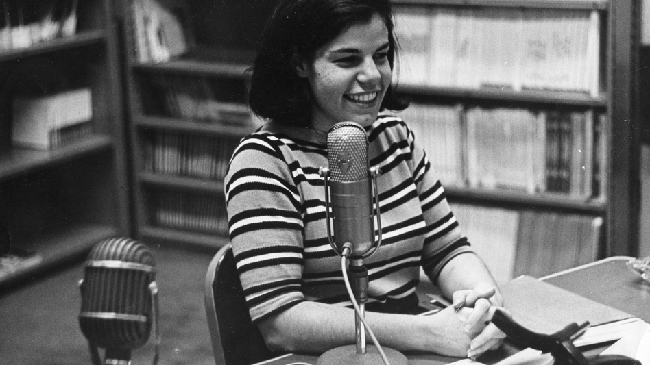 The earliest photo of Susan Stamberg at a microphone, age 25. Later, as the host of <em>All Things Considered,</em> she became the first woman to be a full-time anchor of a national nightly news broadcast in the U.S.