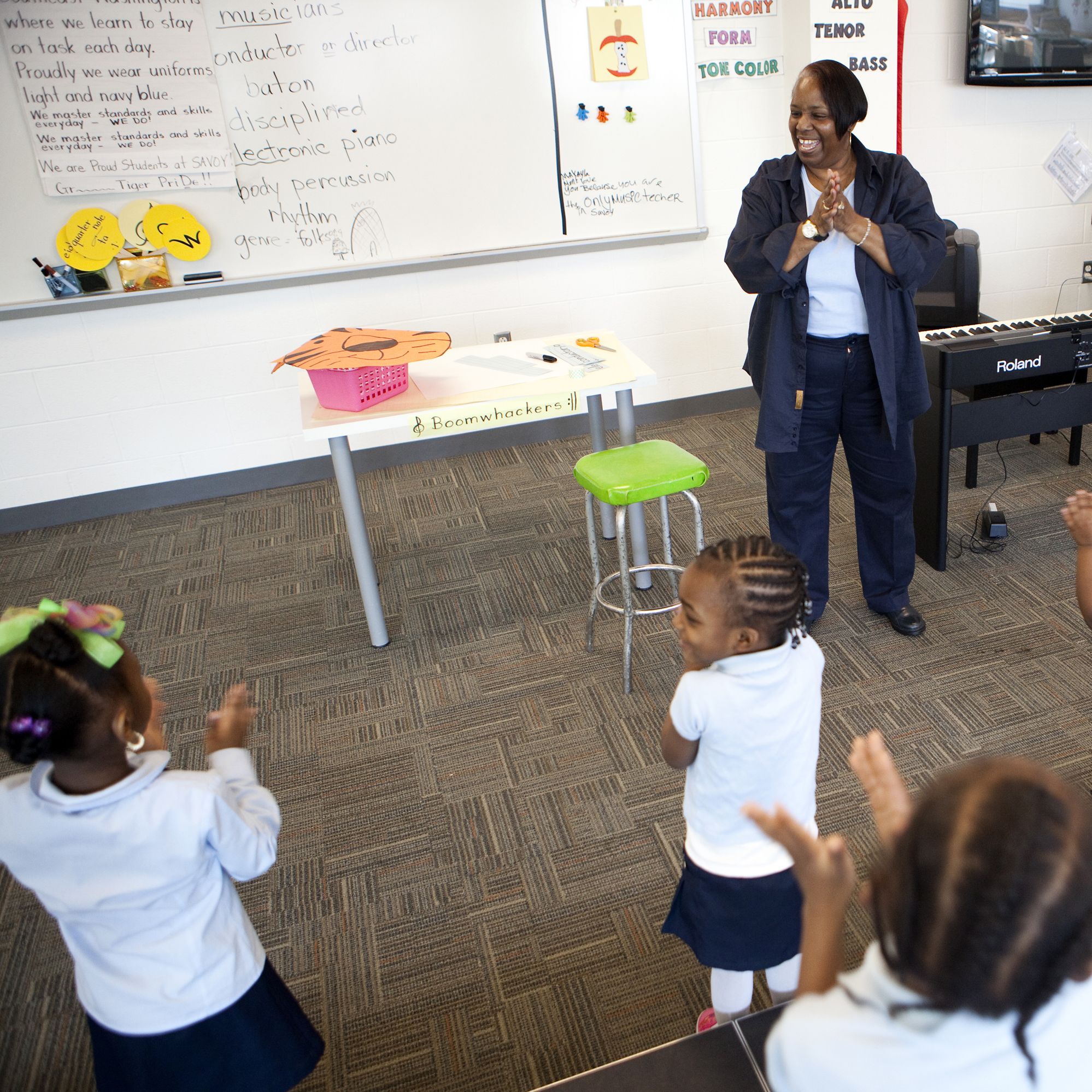 Helen Watson teaches music to a group of Savoy Elementary students on a recent Tuesday morning.
