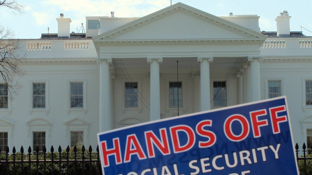 A sign outside the White House on Tuesday protests part of President Obama's proposed federal budget. (MCT/Landov)