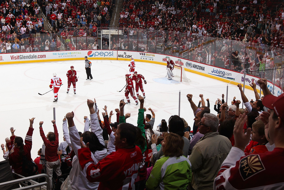 Fans cheer after Martin Hanzal of the Phoenix Coyotes scores an empty-net goal against the Detroit Red Wings in Glendale, Ariz., on April 4.