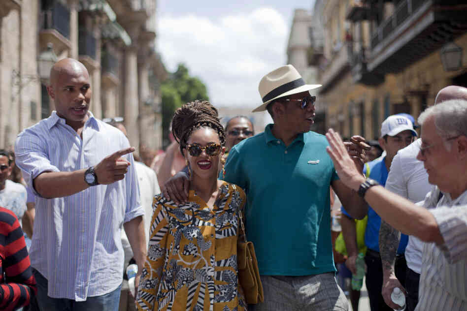 U.S. singer Beyonce and her husband, rapper Jay-Z, right, tours Old Havana as a body guard, left, and tour guide, right, accompany them in Cuba on Thursday, April 4.