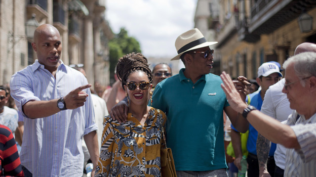 U.S. singer Beyonce and her husband, rapper Jay-Z, right, tours Old Havana as a body guard, left, and tour guide, right, accompany them in Cuba on Thursday, April 4. (AP)