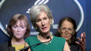 Health and Human Services Secretary Kathleen Sebelius (center), flanked by Centers for Medicare and Medicaid Services Acting Administrator Marilyn Tavenner (left) and Food and Drug Administration Commissioner Margaret Hamburg, speaks du