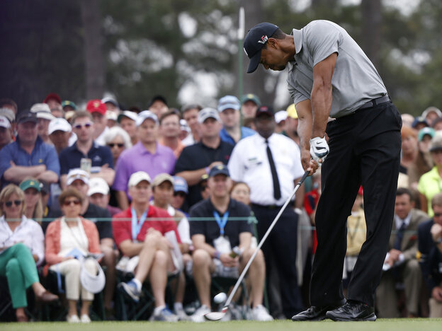 Tiger Woods tees off on the first hole Thursday at the Masters tournament in Augusta, Ga.