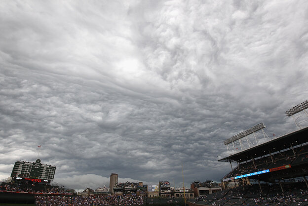 Storm clouds pass over Wrigley Field on July 1, 2011, in Chicago.