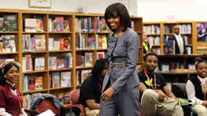 First lady Michelle Obama greets students at Harper High School in Chicago on Wednesday. Twenty-nine current or former Harper students have been shot in the past year, eight of them fatally.