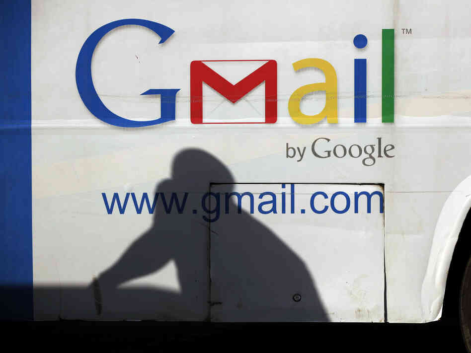 A man's shadow reflects on a bus with an ad for Gmail in Lagos, Nigeria. Google has introduced Inactive Account Manager to help plan for digital life after death.