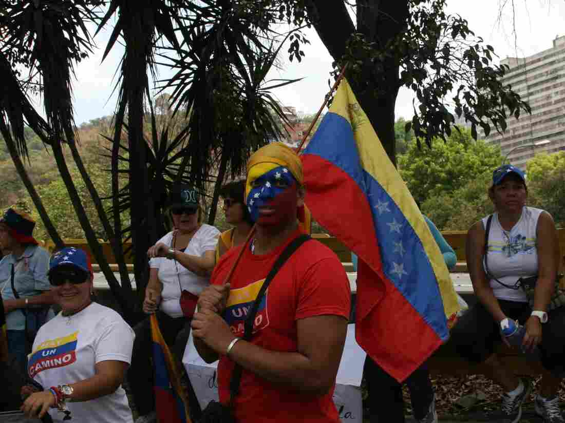 At an opposition rally in Caracas, a supporter of presidential candidate Henrique Capriles wore the Venezuelan colors.