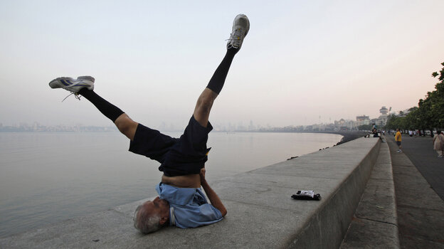 An older man performs exercises in Mumbai, India. Research suggests that moderate physical exercise may be the best way to keep our brains healthy as we age.