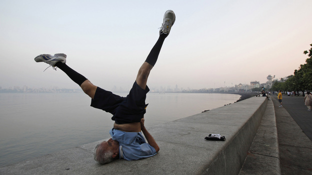 An older man performs exercises in Mumbai, India. Research suggests that moderate physical exercise may be the best way to keep our brains healthy as we age. (AP)