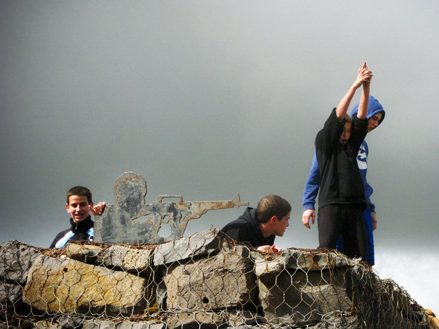 Israeli boys play by metal cutouts of soldiers on the top of Mount Bental, on the Israeli-occupied side of the frontier with Syria.