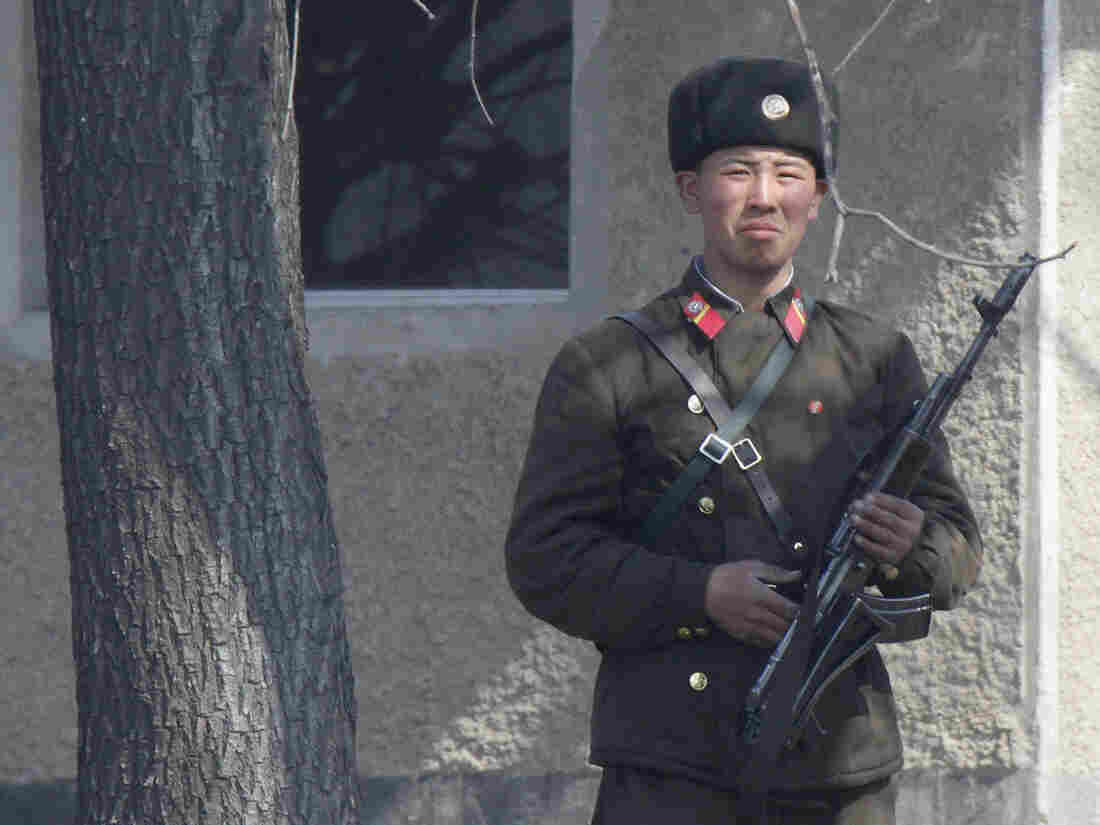 A North Korean soldier on the bank of the Yalu River, near the North Korean town of Sinuiju, along the Chinese border.