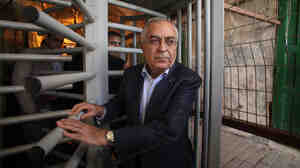Salam Fayyad passes through an Israeli checkpoint in the West Bank town of Hebron in January. This week, he resigned from his post as prime minister of the Palestinian Authority.