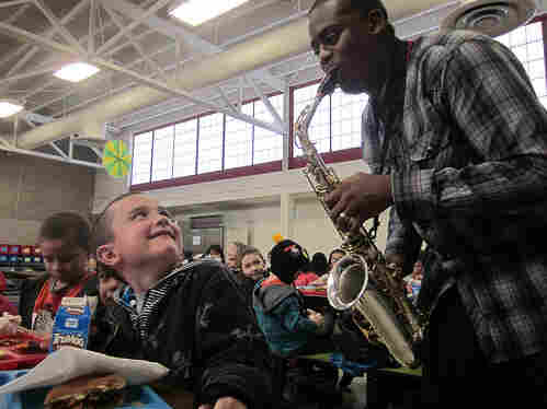 Saxophonist Harold Rapp plays during lunchtime at Alice Terry Elementary School in Sheridan, Colo.