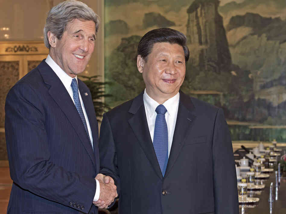 Secretary of State John Kerry shakes hands with Chinese President Xi Jinping before their meeting at the Great Hall of the Pe