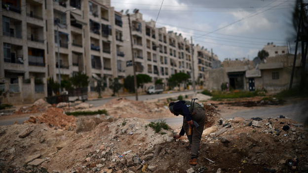 A Syrian rebel patrols the area in the Sheikh Maqsud district of the northern city of Aleppo, on Thursday. (AFP/Getty Images)