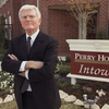 Houston homebuilder Bob Perry, a major player in funding state and national politics, has died at age 80. He's shown here in 2002 at the sales center of one of his developments.