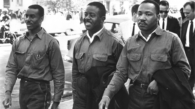 "Martin Luther King Jr., with the Rev. Ralph Abernathy (center) and the Rev. Fred Shuttlesworth, defied an injunction against protesting on Good Friday in 1963. They were arrested and held in solitary confinement in the Birmingham jail where King wrote his famous ""Letter From Birmingham Jail."" (Courtesy of Birmingham Public Library Archives)"