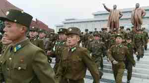 North Korean soldiers marched past statues of founder Kim Il Sung and his son, former leader Kim Jong Il, on Monday in Pyongyang. North Korea celebrated Kim Il Sung's 101st birthday.