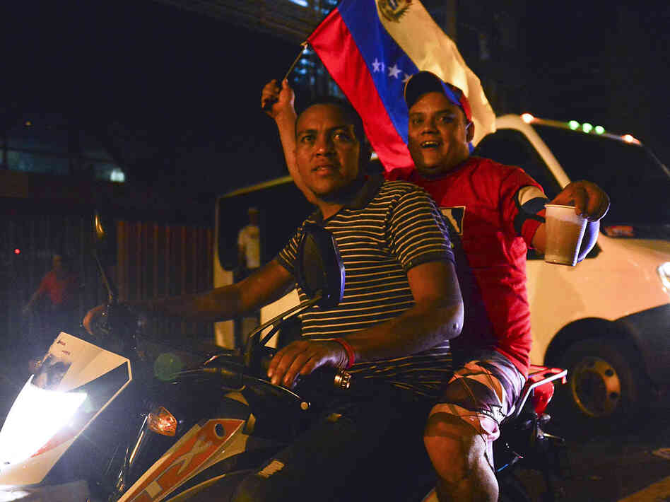 Supporters of acting President Nicolas Maduro celebrated Sunday night in Caracas, Vene