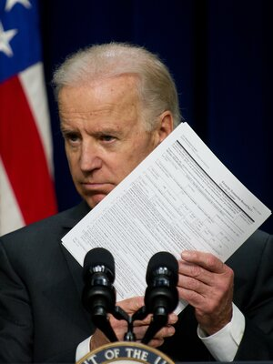 Vice President Joe Biden, holds a background check form last week in Washington, as he c