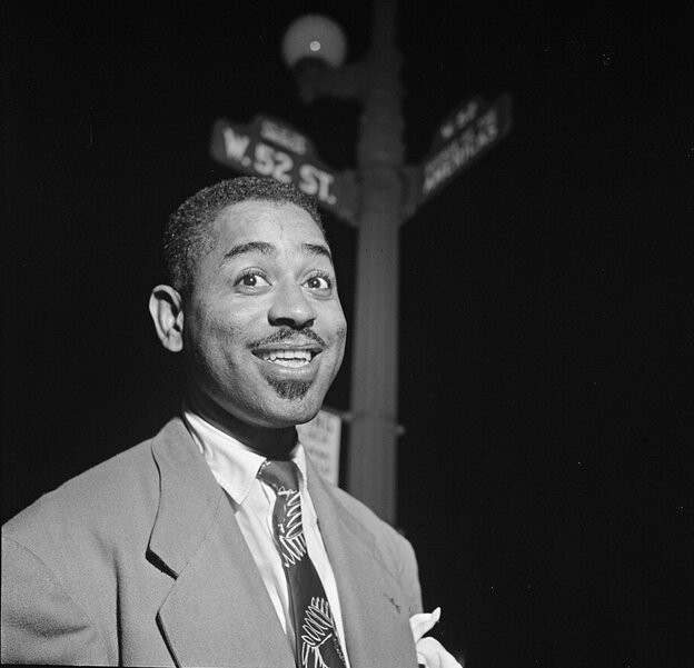 The bebop innovator Dizzy Gillespie on 52nd Street in New York, which was filled with small jazz clubs in the 1940s.