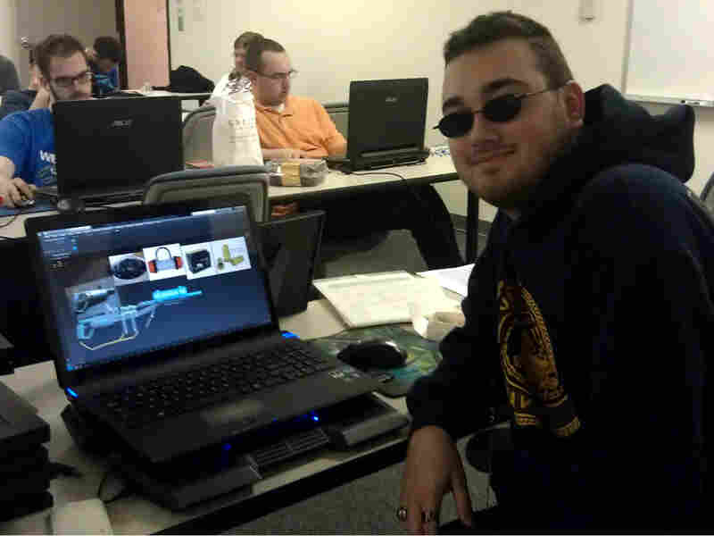 NonPariel student and part-time lab assistant Robert Grimes, 22, finishes up a 3-D model for the game he's creating.