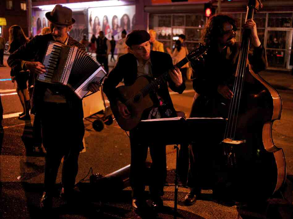 Ten years ago, you wouldn't have seen a sight like this — three white guys playing old-timey music — on the streets of downtown Oakland on a Friday night.