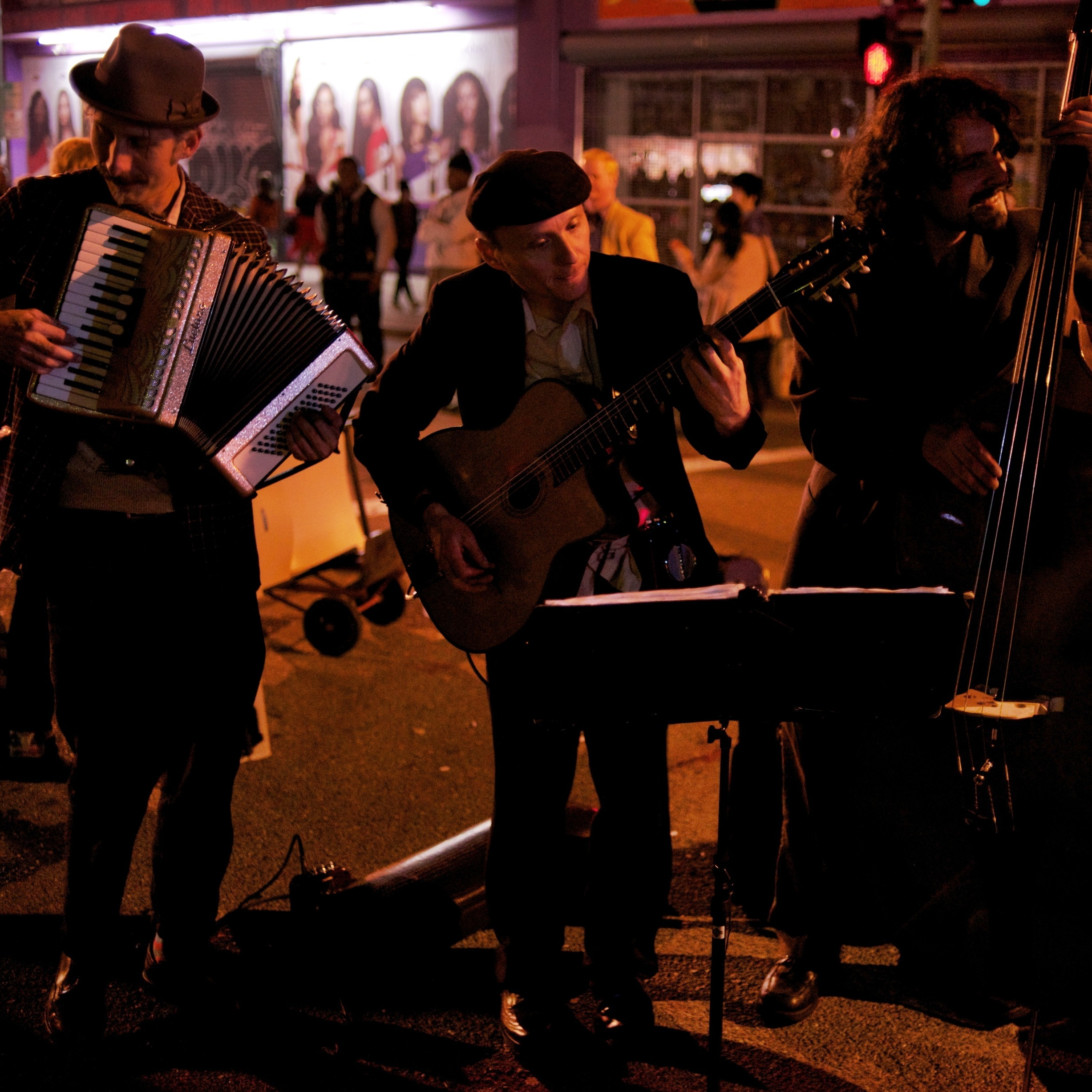 Ten years ago, you wouldn't have seen a sight like this -- three white guys playing old-timey music -- on the streets of downtown Oakland on a Friday night.