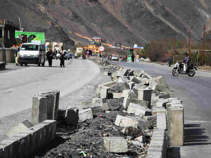 The main road through the Panjshir Valley, shown here April 9, remains under construction. A U.S. reconstruction team started the project in northern Afghanistan, and the provincial government is overseeing the completion.