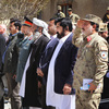 Afghan and U.S. officials attend the closing ceremony for the Paktia provincial reconstruction team on April 9 in eastern Afghanistan. NATO created more than 20 teams to help the Afghans rebuild. But now the U.S. teams are winding down their activities.