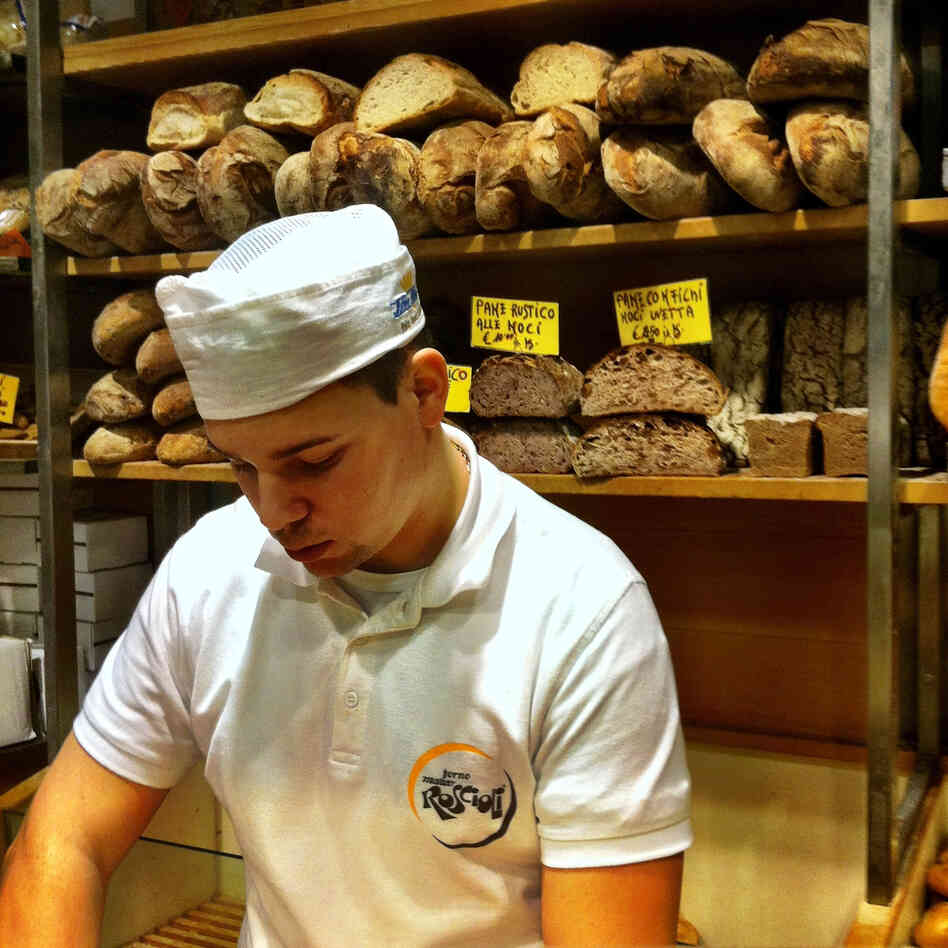 A young baker at the Roscioli bakery in Rome prepares bread.