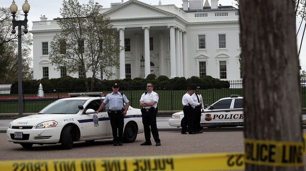 U.S. Secret Service and U.S. Park Police officers stand guard on Pennsylvania Avenue in front of the White House Monday. Security there was tightened after at least two explosions went off near the finish line of the Boston Marathon. (Getty Images)