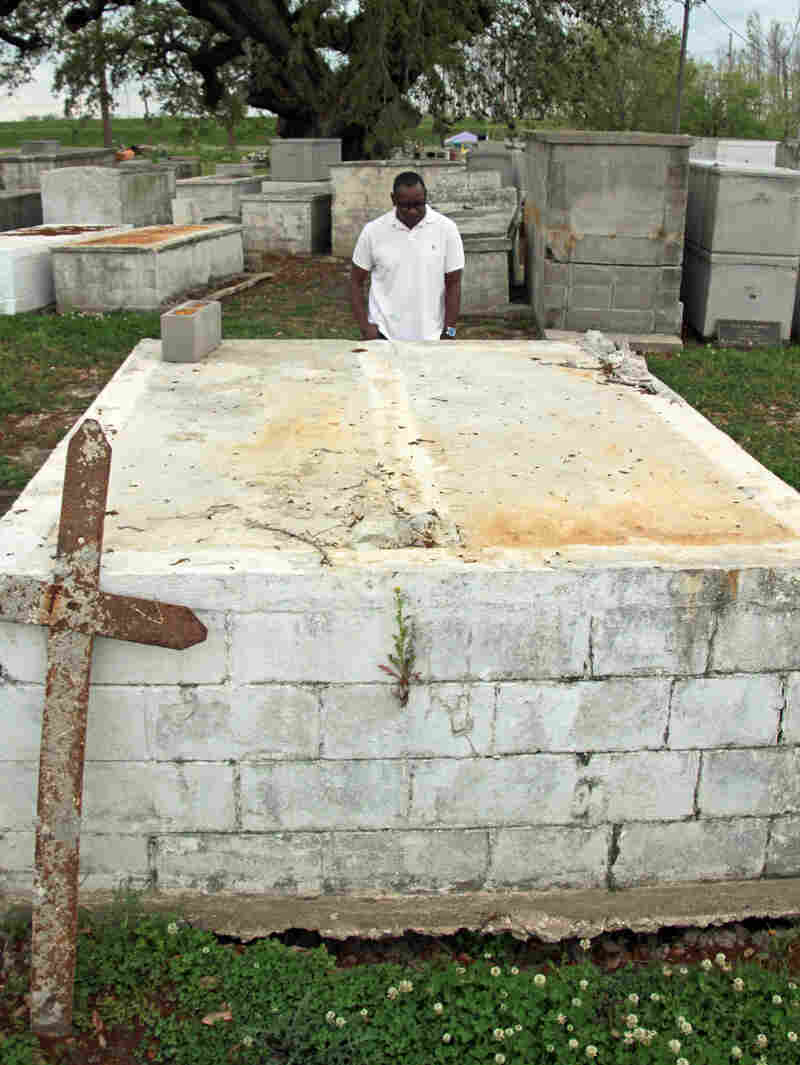 Lionel Alverez stands at a family tomb in Plaquemines Parish, La. Hurricane Isaac's storm surge split the double-decker tomb in half, leaving his aunt's and sister's caskets on the bottom but washing away his mother's, which was on top.