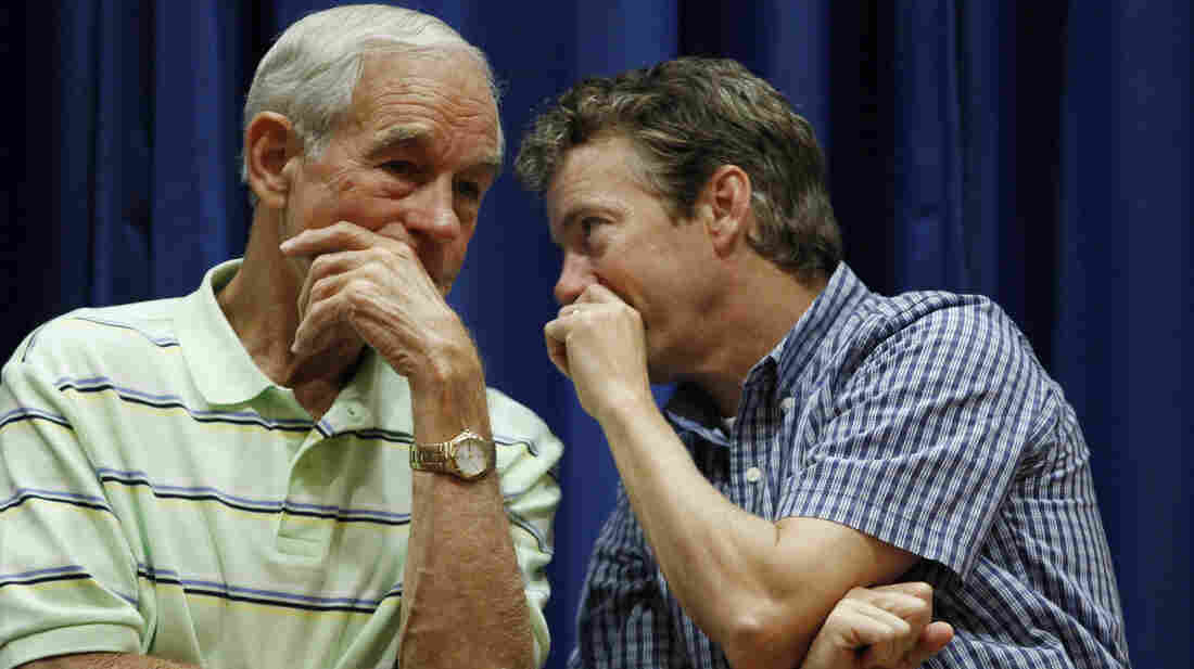 "Texas Republican Rep. Ron Paul and his son Rand Paul, a Republican senator from Kentucky, on stage at a campaign event in Des Moines, Iowa, in 2011. At the time, the elder Paul was seeking the Republican nomination for president. He's now retired from Congress, and the younger Paul says he's ""considering"" his own 2016 bid."