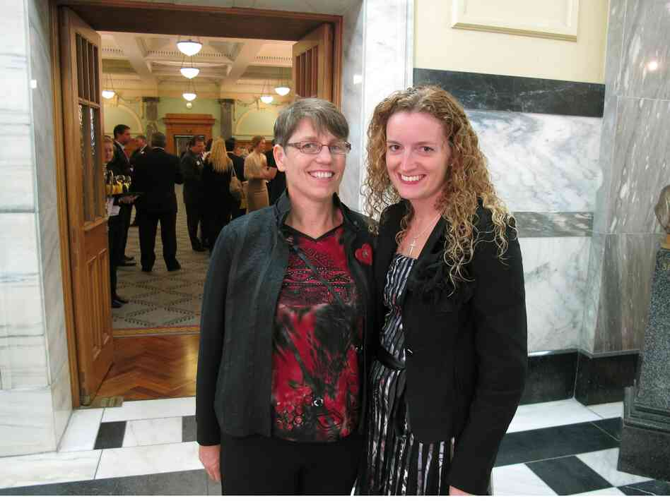 Jills Angus Burney, left, and Deborah Hambly, right, who hope to marry in New Zealand, watch lawmakers ahead of the vote on same-sex marriage on Thursday, April 17, 2013.