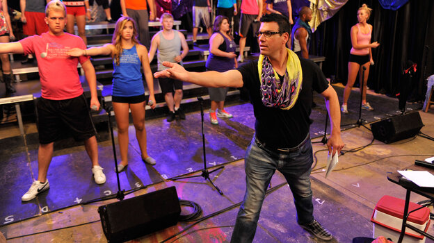 Director Rob takes charge of a rehearsal in VH1's Off Pitch.