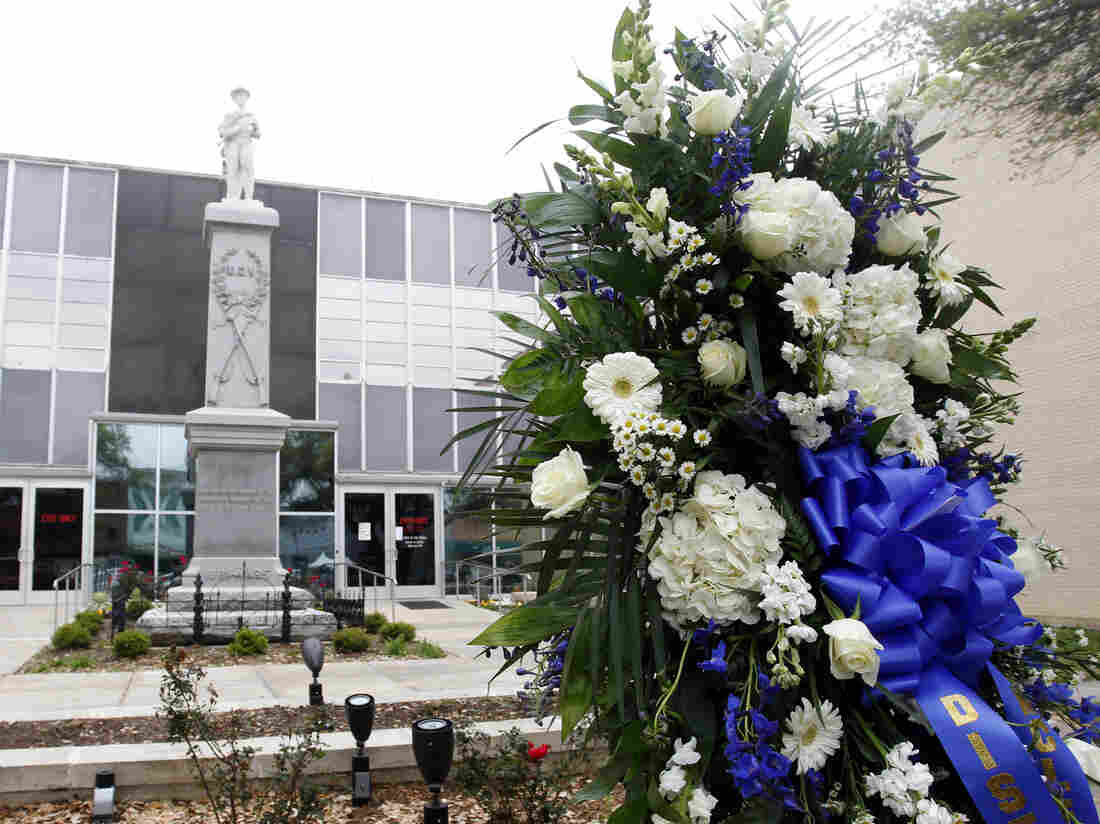 A wreath of flowers in honor of slain District Attorney Mike McClelland at the Kaufman County [Texas] Courthouse in early April.