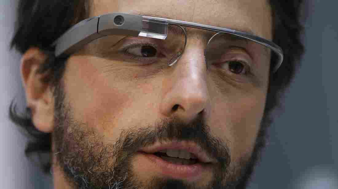 Google co-founder Sergey Brin shows off Google Glass in February. Brin says the camera displays an external light when filming, making it difficult for a user to record surreptitiously.