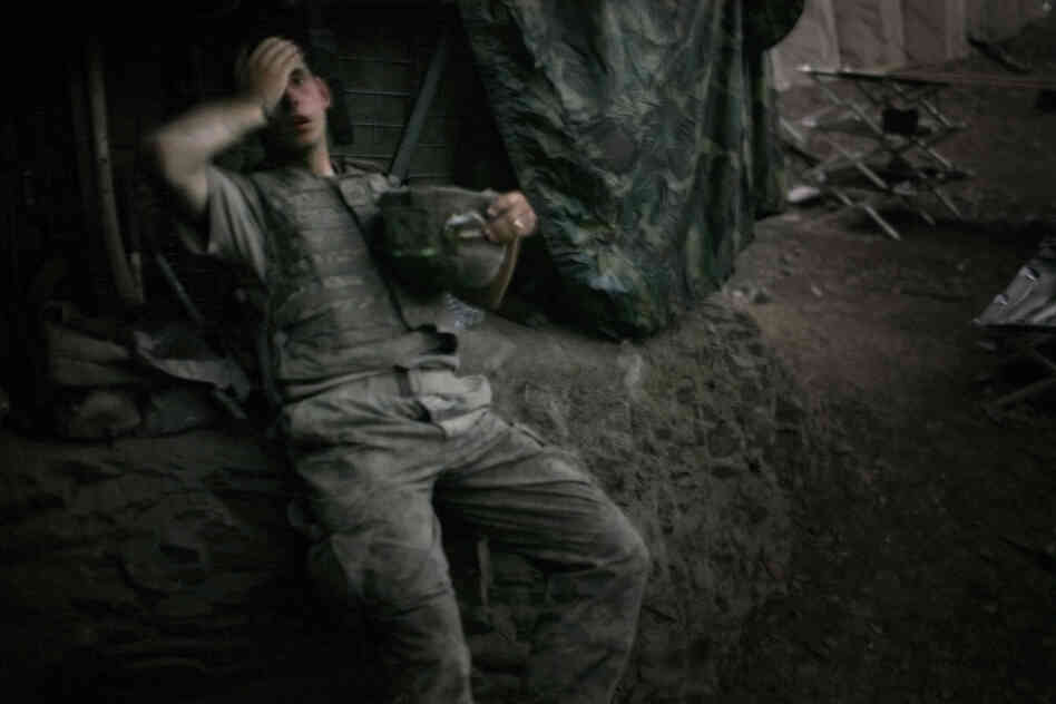 "A soldier rests at the end of a day of heavy fighting at the Restrepo outpost in Afghanistan's Korengal Valley. This image won the 2007 World Press Photo of the Year award. ""The funny thing about war, it actually almost never hardens people,"" Junger says. &q"
