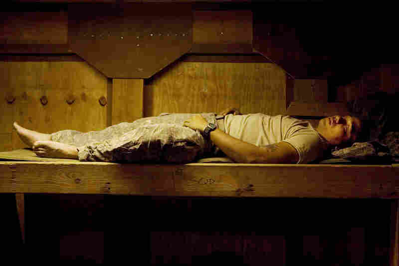 "Soldier Ryan Lizama sleeping at an outpost in the Korengal, June 2008. From the book Infidel. ""Tim said, 'This is what the American public never gets to see, because any nation is self-selecting in the images it presents,' "" Junger remembers. "" 'And we want to see our soldiers as strong.' """