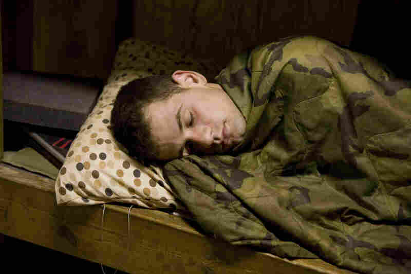 """Forward observer Murphy sleeping, Korengal, July 2008. """"I thought nothing was going on because there was no combat,"""" Junger recalls. """"And Tim saw potential in everything, including a situation where nothing's happening."""""""