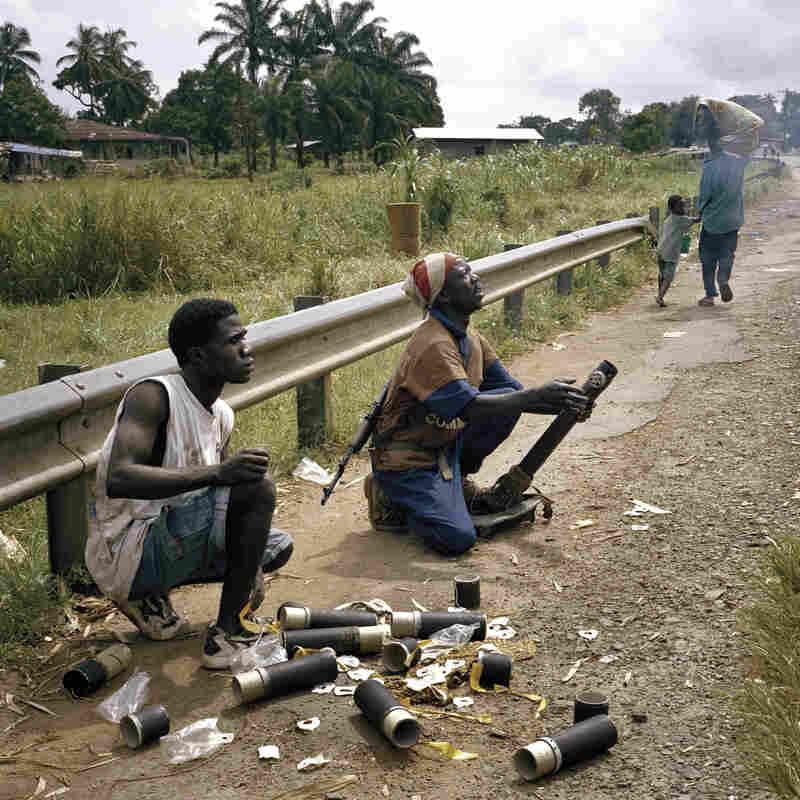"Liberian rebels bomb the nation's capital, Monrovia, using American-manufactured mortars, in 2003. More than 1,000 people died during the siege. ""One of the scary things about working in civil wars like that is, you're not even sure you can trust the people you're with,"" Junger says. ""They're very young, they're very hopped up, and it's very easy to feel like they can turn on you in an instant."""