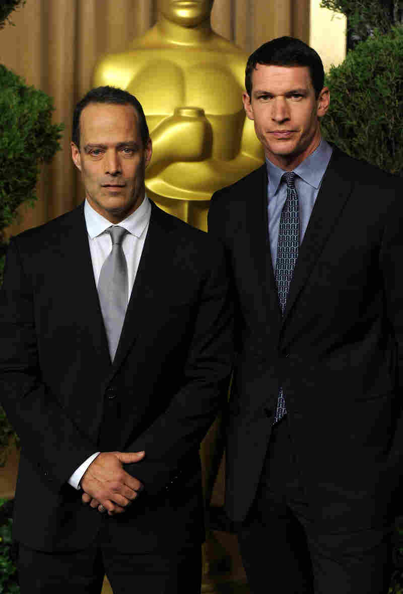 Sebastian Junger (left) and Tim Hetherington are seen at an Academy Awards luncheon in February 2011. Junger's new documentary explores the life of Hetherington, who was killed in Misrata, Libya, in April 2011.