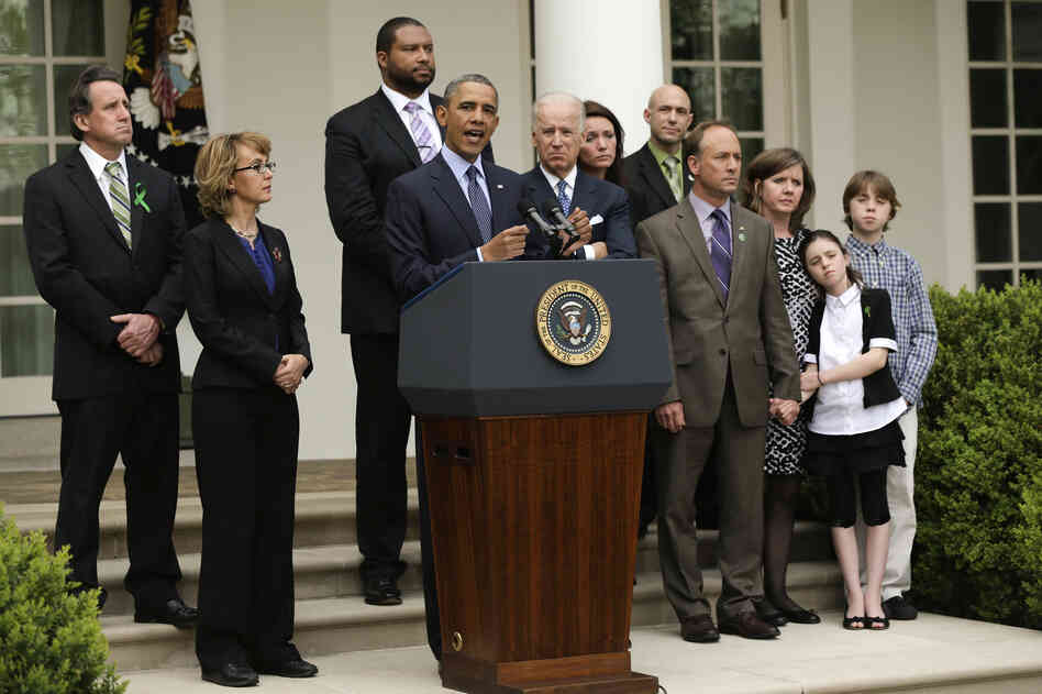 President  Obama makes a statement on gun violence as Vice President Joe Biden, former U.S. Rep. Gabrielle Giffords and family members of Newtown, Conn., shooting victims look on at the White House Rose Garden.