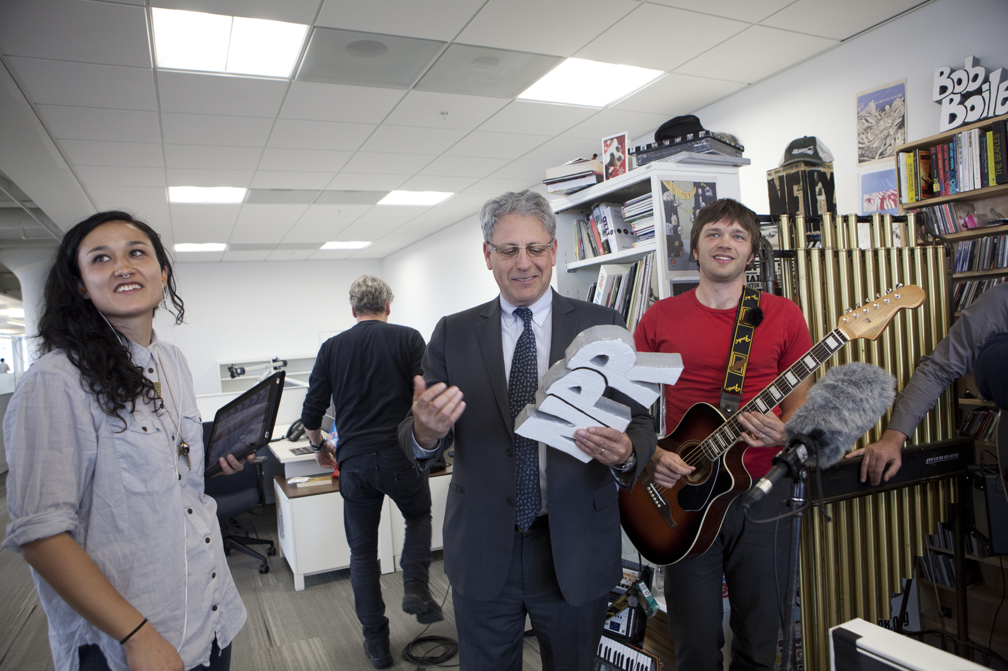 NPR President and CEO Gary E. Knell joins the in film-making fun at the new Tiny Desk space. Pictured are NPR Music's Mito Habe-Evans (left), Knell and OK Go guitarist Andy Ross.