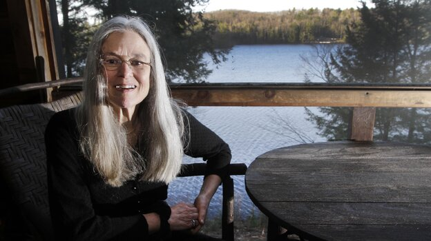 Sharon Olds'  poses on the porch of her home in Pittsfield, N.H., on Monday, when it was announced that her poetry collection title