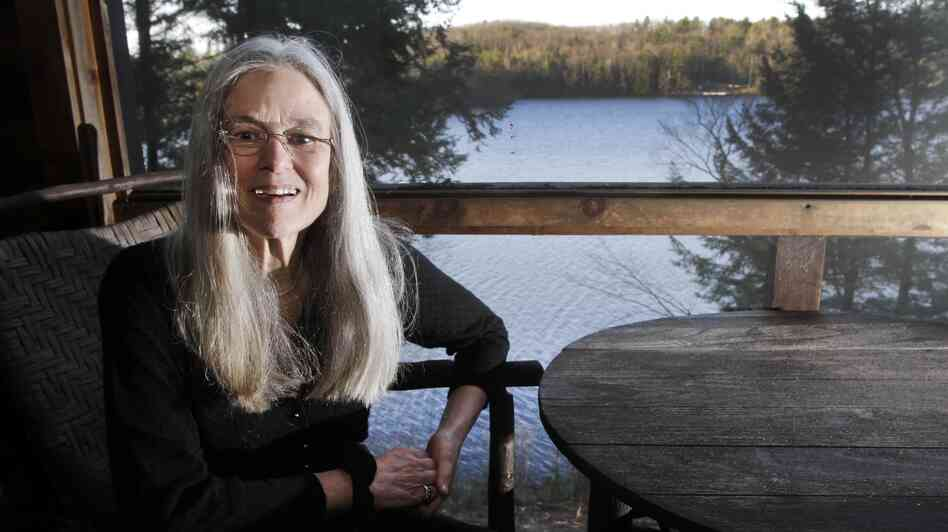 Sharon Olds'  poses on the porch of her home in Pittsfield, N.H., on Monday, when it was announced that her poetry collection titled Stag's Leap had won a Pulitzer.