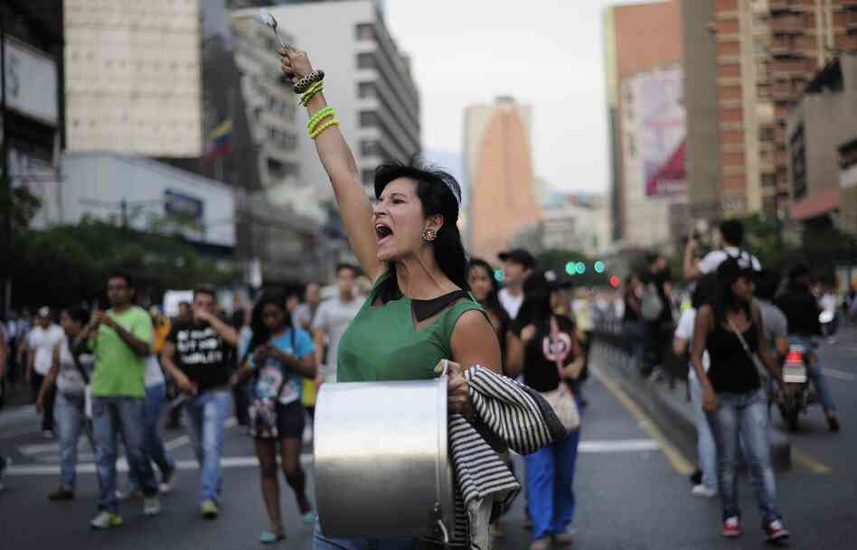 Supporters of Venezuelan opposition presidential candidate Henrique Capriles protest in the area of Altamira, in Caracas, capital of Venezuela, on Monday.
